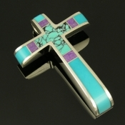Sterling silver cross by jewelry artist Mark Hileman. Silver cross inlaid with turquoise, sugilite and spiderweb turquoise.