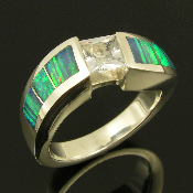 Unique handmade sterling silver white sapphire ring inlaid with Australian crystal opal. Beautiful blue-green Australian opal with a striated pattern is inlaid into a heavy sterling silver ring mounting with a gentle curve design.