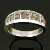 Woman's handmade sterling silver ring inlaid with dinosaur bone. The ring is inlaid with 7 pieces of unique gem dinosaur bone.