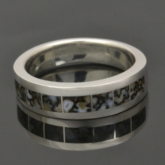 Sterling silver man's ring band inlaid with dinosaur bone by jewelry artisan Mark Hileman.