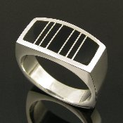 Contemporary sterling silver man's ring inlaid with black onyx by jewelry artisan Mark Hileman.