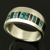 Woman's sterling silver ring band inlaid with black onyx and spiderweb turquoise with black matrix.