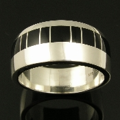 Handmade sterling silver man's band inlaid with black onyx by jewelry artist Mark Hileman. This contemporary silver inlay ring would make a great alternative man's wedding band.