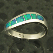 Unique handmade sterling silver ring inlaid with Australian opal. Flowing curves inlaid with 6 pieces of outstanding blue-green Australian crystal opal.