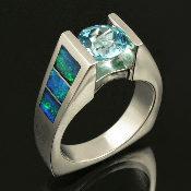 Sparkling blue topaz sterling silver ring inlaid with bright blue-green Australian crystal opal. The inlaid blue-green firing Australian opal is a nice accent to the blue topaz.