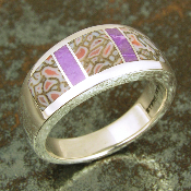 Handmade sterling silver ring inlaid with sugilite and dinosaur bone. The ring is inlaid with 3 pieces of unique gem dinosaur bone and 2 pieces of lavender sugilite.
