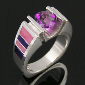 Ladies sterling silver amethyst ring with sugilite and nambulite inlay. A beautiful 1.75 carat purple amethyst is channel set on the top of this unique silver ring.
