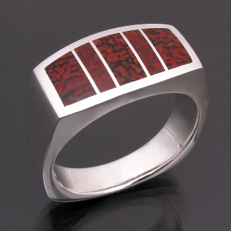 Man's sterling silver ring inlaid with dinosaur bone by Hileman Silver Jewelry. This handmade ring is inlaid with 2 different kinds of gem dinosaur bone- red orange with black matrix and reddish brown with grey matrix.
