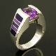 Handmade sterling silver woman's ring featuring a 1.77 carat oval cut Amethyst accented by inlaid lavender and purple sugilite by jewelry artist Mark Hileman. Ring measures 10mm at the top and tapers to 4mm at the shank and is a size 6 3/4.