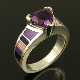 Sterling silver ring featuring a 1.6 carat Amethyst accented by Australian opal and sugilite inlay. Inlaid lavender and purple sugilite combine with red Australian opal for a striking accent to the 8mm trillion cut purple amethyst.