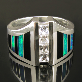 Striking sterling silver man's white sapphire ring inlaid with black onyx and Australian opal. Four sparkling princess cut white sapphires totaling .88 carats are channel set across the top of the ring.