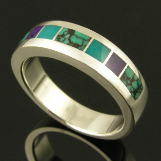 Man's handmade sterling silver ring inlaid with sugilite, gem silica and spiderweb turquoise inlay. Nice blue spiderweb turquoise with dark veining is inlaid in the ends and center sections.
