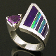 Handmade sterling silver woman's amethyst ring inlaid with Australian opal and purple sugilite. The purple sugilite inlay looks great with the .66 carat purple trillion cut amethyst.