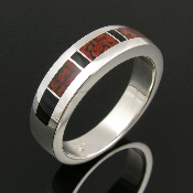 Mans dinosaur bone and black onyx ring in sterling silver. Red gem dinosaur bone inlay with black onyx accents by Hileman.