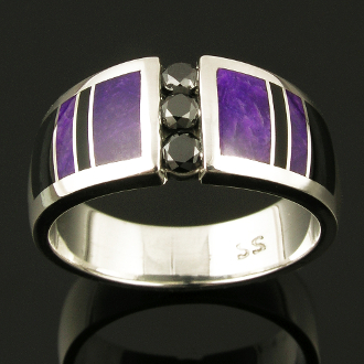 Unique sterling silver black diamond wedding ring inlaid with sugilite and black onyx. Handmade wedding ring features 3 channel set round black diamonds flanked by alternating black onyx and purple sugilite inlay.