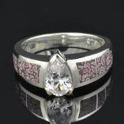 Pink dinosaur bone engagement ring with white sapphire. This dinosaur bone ring would make a great wedding ring or engagement ring.