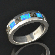 Dinosaur bone ring with lab created opal inlaid in sterling silver by Hileman Silver Jewelry. Gray dinosaur bone and blue green lab opal.