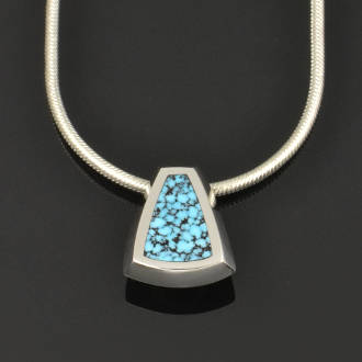 Handmade sterling silver pendant inlaid with genuine Kingman spiderweb turquoise.