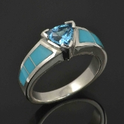 Sterling silver blue topaz ring inlaid with Sleeping Beauty turquoise. Swiss blue1.00 carat trillion cut topaz accented by blue turquoise sections separated by thin silver dividers.