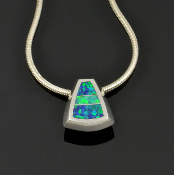 Lab opal pendant handcrafted in sterling silver by Hileman Silver Jewelry. Simple pendant inlaid with blue-green lab created opal for everyday wear.
