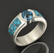 Men's turquoise wedding band with London blue topaz set in sterling silver. The spiderweb turquoise looks great with the blue topaz in this handcrafted wedding band.